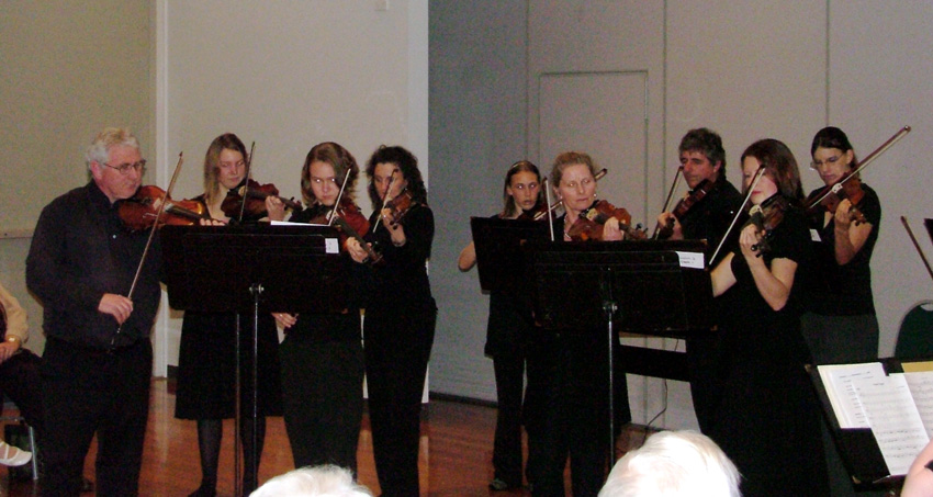 The Strings standing to play their pieces and making a very professional sound as well as appearance! L to R - Peter Read, Mali Lewis, Rebecca Jennings, Alison Smith, Lyndel Speedy, Wendy Oakes, Philip Oakes, Melody O'Meara and Donna Hogan.