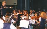 WINDS AND STRINGS IN SPRING - 1998 in Westside PAC, Mooroopna. Notice Adeline Brunet in the first violins. She was an exchange student from France and played with the orchestra for that year. Notice also Lauren McDonald leading the orchestra.