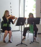 Ruth Dodson and Alison Smith playing violin in the String Quartet. The quartet performed all three movements of