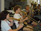 Three brass players, Lachlan, Simon and Paul.
