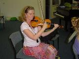 Wendy playing at the rehearsal at the back of the first violins.