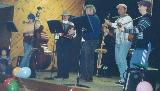 The bush band at Camp Howqua, 1999. Leanda Smith, Bass, Helen Rankin, Accordeon, Peter Read, fiddle, Erin Lancaster (?), lagerphone, Phil Oakes, guitar, and Linden Lancaster, guitar.