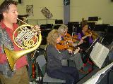Sarg playing the Mozart Horn Concerto with a chamber group from the orchestra