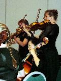 Carole McGregor, Demi Wood and Vicki Prewett playing during one of the String Ensemble pieces
