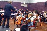 Guest Conductor Ben Northey conducting the lower strings