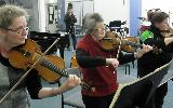The three violins rehearsing for the Brandenberg 3