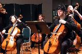 cellos performing in the Brandenberg Concerto No 3