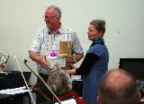 Wendy presenting Laurie and the Orchestra Victoria members with some wine and chocolates at the end of the workshop