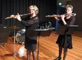 Bass flute, played by Vicki Prewett and Alto Flute played by Cindy Abbey