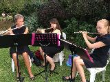 Flute players, Vicki Prewett, Lia D'Augello and Rachel Keen performing at Opera in the Orchard