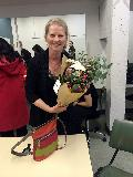 Wendy Oakes OAM, with the flowers given to her by Demi Wood at the annual concert, and as congratulations for receiving an OAM!