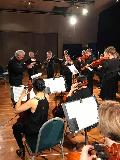 The String Ensemble played 4 pieces, including Danse Carnivale by Randall Standridge, conducted by Peter Read.