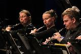 Jill Clapperton and Kathleen Mills playing flute and Johnathon Bentancourt playing the Oboe